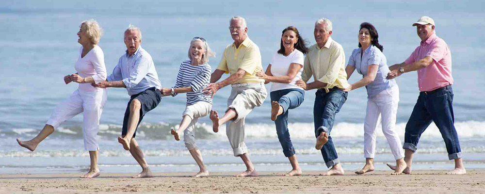 Eight retirees congoing on the beach